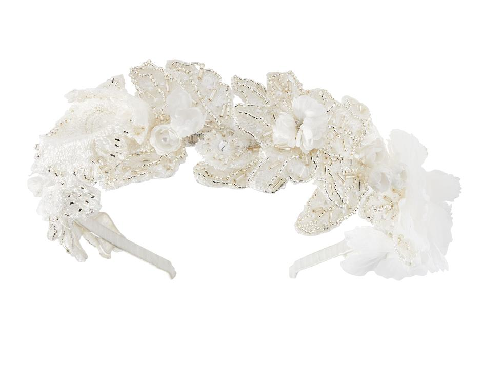 Headpiece with cream-coloured details