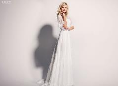 Bröllopsklänning med spets arm